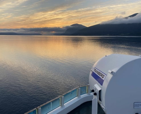 Sunset view from ship with TRANBERG searchlight